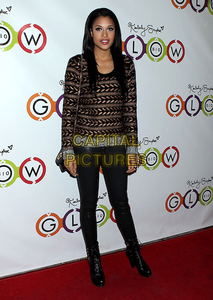 Kali Hawk.Opening Of Kimberly Snyder's Glow Bio held at Glow Bio, West Hollywood, California, USA, 14th November 2012..full length brown patterned jumper sweater jeans black boots .CAP/ADM/RE.©Russ Elliot/AdMedia/Capital Pictures.