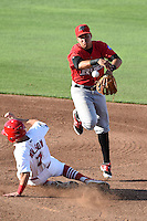 Frisco Rough Riders second baseman Edwin Garcia (2) attempts to turn a double play as Jacob Wilson (7) slides in during a game against the Springfield Cardinals on June 1, 2014 at Hammons Field in Springfield, Missouri.  Springfield defeated Frisco 3-2.  (Mike Janes/Four Seam Images)