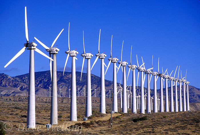 730850252 green power generation represented by this huge wind turbine farm in the wind blown hills to the west of mojave in kern county california