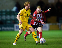 Lincoln City's Anthony Scully vies for possession with Milton Keynes Dons' Dean Lewington<br /> <br /> Photographer Andrew Vaughan/CameraSport<br /> <br /> The EFL Sky Bet League One - Lincoln City v Milton Keynes Dons - Tuesday 11th February 2020 - LNER Stadium - Lincoln<br /> <br /> World Copyright © 2020 CameraSport. All rights reserved. 43 Linden Ave. Countesthorpe. Leicester. England. LE8 5PG - Tel: +44 (0) 116 277 4147 - admin@camerasport.com - www.camerasport.com