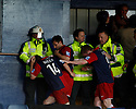 York City players cover try to protect themselves to avoid being hit by missiles from Luton fans after the Blue Square Premier play-off semi-final 2nd leg  match between Luton Town and York City at Kenilworth Road, Luton on Monday 3rd May, 2010..© Kevin Coleman 2010 ..