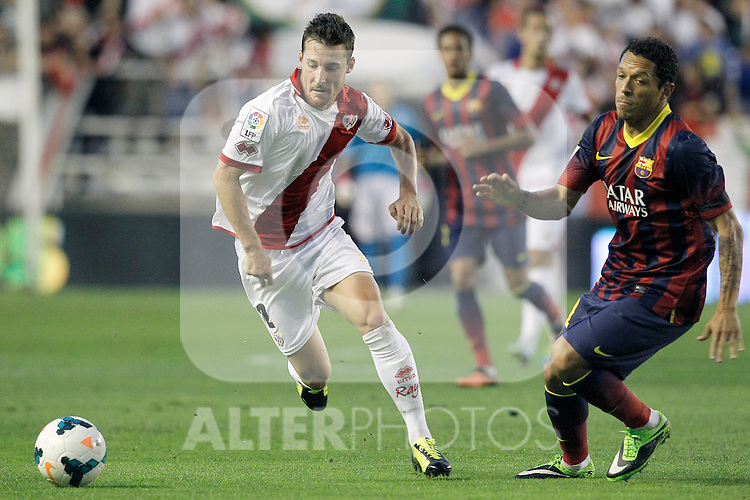 Rayo Vallecano's Tito (l) and FC Barcelona's Adriano Correia during La Liga match.September 21,2013. (ALTERPHOTOS/Acero)