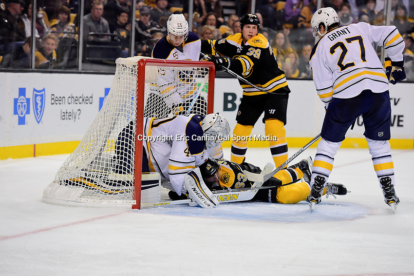Monday, November 7, 2016: Boston Bruins left wing Brad Marchand (63) lands in the net guarded by Buffalo Sabres goalie Robin Lehner (40) during the National Hockey League game between the Buffalo Sabres and the Boston Bruins held at TD Garden, in Boston, Mass. Boston defeats Buffalo 4-0.  Eric Canha/CSM