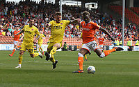 Fleetwood Town's Ashley Eastham blocks this shot from Blackpool's Armand Gnanduillet<br /> <br /> Photographer Stephen White/CameraSport<br /> <br /> The EFL Sky Bet League One - Blackpool v Fleetwood Town - Monday 22nd April 2019 - Bloomfield Road - Blackpool<br /> <br /> World Copyright © 2019 CameraSport. All rights reserved. 43 Linden Ave. Countesthorpe. Leicester. England. LE8 5PG - Tel: +44 (0) 116 277 4147 - admin@camerasport.com - www.camerasport.com