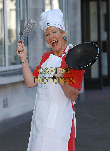 CHRISTINE HAMILTON.Seeds for Africa charity photocall.half length, half-length, frying pan, chef's hat.sales@capitalpictures.com.www.capitalpictures.com.©Capital Pictures