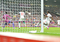 July 26, 2012..Britain's Craig Bellamy (obstructed by the goal post) scores against Senegal. Great Britain vs Senegal Football match during 2012 Olympic Games at Old Trafford in Manchester, England. Senegal held Great Britain to a 1-1 draw...(Credit Image: © Mo Khursheed/TFV Media)