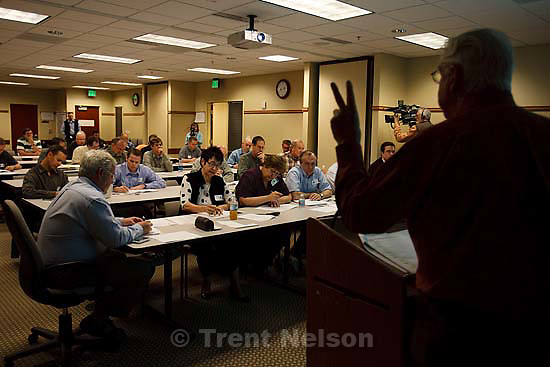 Salt Lake City - Auctioneer Blaine Parker conducts an oil- and gas-lease sale at the Bureau of Land Management office,  Tuesday March 24, 2009. 3.24.2009.