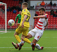 Fleetwood Town's Ashley Hunter is tackled by Doncaster Rovers' Andrew Butler<br /> <br /> Photographer David Shipman/CameraSport<br /> <br /> The EFL Sky Bet League One - Doncaster Rovers v Fleetwood Town - Saturday 6th October 2018 - Keepmoat Stadium - Doncaster<br /> <br /> World Copyright © 2018 CameraSport. All rights reserved. 43 Linden Ave. Countesthorpe. Leicester. England. LE8 5PG - Tel: +44 (0) 116 277 4147 - admin@camerasport.com - www.camerasport.com