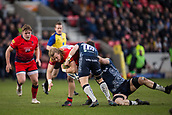 24th March 2018, AJ Bell Stadium, Salford, England; Aviva Premiership rugby, Sale Sharks versus Worcester Warriors; David Denton of Worcester Warriors is tackled by AJ MacGinty of Sale Sharks