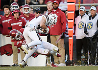 NWA Democrat-Gazette/CHARLIE KAIJO Arkansas defensive back LaDarrius Bishop (24) tackles Mississippi State tight end Brad Cumbest (25), Saturday, November 2, 2019 during the third quarter of a football game at Donald W. Reynolds Razorback Stadium in Fayetteville. Visit nwadg.com/photos to see more photographs from the game.