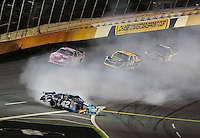Oct. 17, 2009; Concord, NC, USA; NASCAR Sprint Cup Series driver Juan Pablo Montoya (42) spins during the NASCAR Banking 500 at Lowes Motor Speedway. Mandatory Credit: Mark J. Rebilas-