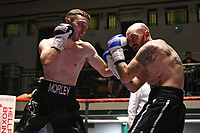 Dan Morley (black gloves) defeats Danny Little during a Boxing Show at York Hall on 2nd February 2019