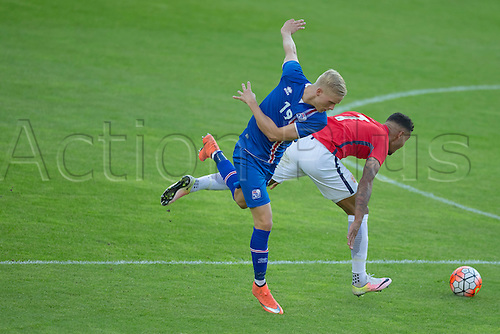01.06.2016  Ullevaal Stadion, Oslo, Norway.  Horour Bjorgvin Magnusson of Iceland holds off a challenge from  Joshua King of Norway during the International Football Friendly match between Norway and Iceland at the Ullevaal Stadion in Oslo, Norway.