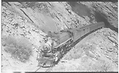D&amp;RGW Mountain #1703 exiting a tunnel west of Denver with a passenger train.<br /> D&amp;RGW    Taken by Perry, Otto C.