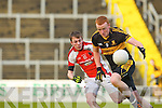 Johnny Buckley Crokes goes past George O'Keeffe Rathmore during the O'Donoghue Cup final in Fitzgerald Stadium on Sunday