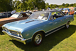 Old Westbury, New York, U.S. - June 1, 2014 - A blue 1967 Chevrolet Chevelle SS 396, owner ARTIE STAVROS of LEVITTOWN, is an entry at the Antique and Collectible Auto Show held on the historic grounds of elegant Old Westbury Gardens in Long Island, and sponsored by Greater New York Region AACA Antique Automobile Club of America.