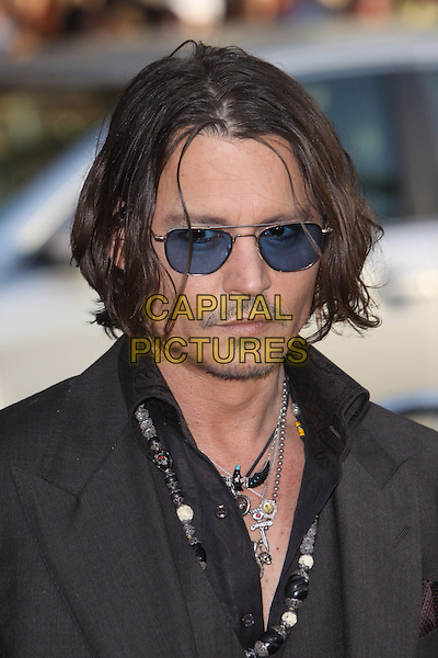 Johnny Depp.'Dark Shadows' Los Angeles premiere held at Grauman's Chinese Theatre, Hollywood, California, USA..7th May 2012.headshot portrait stubble necklaces black facial hair sunglasses shades .CAP/ADM/CH.©Charles Harris/AdMedia/Capital Pictures