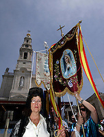 Pilgrim during the procession  of Fatima in central Portugal .Thousands of pilgrims converged on Fatima Santuary to celebrate the anniversary of the Fatima miracle when three shepherd children claimed to have seen the Virgin Mary in May 1917. Reportedly the aparition of a shining lady told the children - Lucia, Francisco, and Jacinta - to meet her in the same place on the 13th day of each month until October.