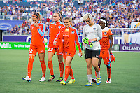 Orlando, Florida - Saturday, April 23, 2016: Houston Dash defender Stephanie Ochs (22), midfielder Cami Privett (23), forward Kealia Ohai (7) and goalkeeper Bianca Henninger (1) walk to the bench following introductions during an NWSL match between Orlando Pride and Houston Dash at the Orlando Citrus Bowl.