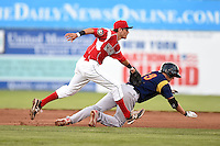 Batavia Muckdogs shortstop Aaron Blanton (11) tags out Danny Diekroeger (19) during a game against the State College Spikes on July 3, 2014 at Dwyer Stadium in Batavia, New York.  State College defeated Batavia 7-1.  (Mike Janes/Four Seam Images)