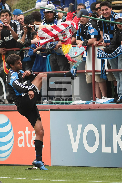 Chris Wondolowski kicks the pinata for the fans. Chivas USA defeated the San Jose Earthquakes 2-1 at Buck Shaw Stadium in Santa Clara, California on April 23rd, 2011.