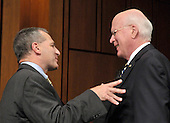 Washington, DC - July 13, 2009 -- United States Senator Patrick Leahy (Democrat of Vermont), right, shares some thoughts with former Federal Bureau of Investigation (FBI) Director Louis Freeh following the first day of testimony as the U.S. Senate Judiciary Committee considers the nomination of Judge Sonia Sotomayor as Associate Justice of the U.S. Supreme Court on Monday, July 13, 2009..Credit: Ron Sachs / CNP