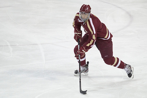 Boston College defenseman Tommy Cross (#4) skates with the puck in action during NCAA hockey game between Notre Dame and Boston College.  The Notre Dame Fighting Irish defeated the Boston College Eagles 3-2 in game at the Compton Family Ice Arena in South Bend, Indiana.