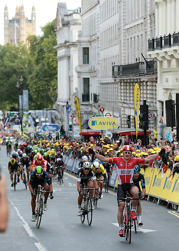 13.09.2015. London, England. Tour of Britain Stage Eight. London Finish. Andre Greipel of Lotto Soudal celebrates winning but is unaware he is due to be stripped of the win for cutting in front of Elia Viviani of Team Sky handing the stage win to Elia Viviani of Team Sky