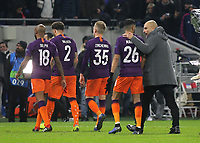 Manchester City Manager, Pep Guardiola shows his delight as he puts his arm around Riyad Mahrez as his team leaves the field after the match during Lyon vs Manchester City, UEFA Champions League Football at Groupama Stadium on 27th November 2018