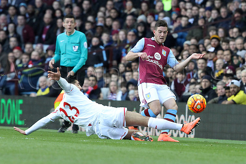 14.02.2016. Villa Park, Birmingham, England. Barclays Premier League. Aston Villa versus Liverpool. Jordan Veretout  of Aston Villa is tackled by Emre Can of Liverpool