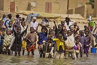 Children saying  goodbye to the fisherman