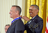 United States President Barack Obama presents the Presidential Medal of Freedom to actor and filmmaker Tom Hanks during a ceremony in the East Room of the White House in Washington, DC on Tuesday, November 22, 2016.  The Presidential Medal of Freedom is the Nation's highest civilian honor.<br /> Credit: Ron Sachs / CNP