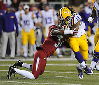 NWA Media/ANDY SHUPE - Arkansas' Braylon Mitchell (34) makes a move to tackle LSU's Terrence Magee (18) during the second quarter Saturday, Nov. 15, 2014, at Razorback Stadium in Fayetteville.