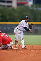 GCL Yankees East second baseman Miguel Marte (1) throws to first base as Sam Gozzo (4) slides in during a Gulf Coast League game against the GCL Phillies West on July 26, 2019 at the New York Yankees Minor League Complex in Tampa, Florida.  (Mike Janes/Four Seam Images)