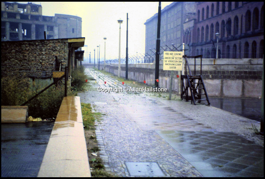 BNPS.co.uk (01202 558833)<br /> Pic: AllanHailstone/BNPS<br /> <br /> Walled off Stresemannstrasse in the American sector in 1962<br /> <br /> New book reveals unseen pictures of the bleak landscape of Cold War Berlin.<br /> <br /> The remarkable photos were taken by a British visitor before and after the Berlin Wall was built in 1961.<br /> <br /> Retired coin dealer Allan Hailstone visited Berlin several times between 1959 and 1966 and took hundreds of photos of both West Berlin and East Berlin.<br /> <br /> The 78 year old was struck by the stark contrast between the vibrant, colourful West Berlin he encountered and rubble-filled, sparse East Berlin.<br /> <br /> During his first visit to Berlin in 1959, Mr Hailstone was able to walk freely between the two sides of the city, but this changed when he returned in 1962 as the Berlin Wall had been built to stop east Berliners from escaping to the west.