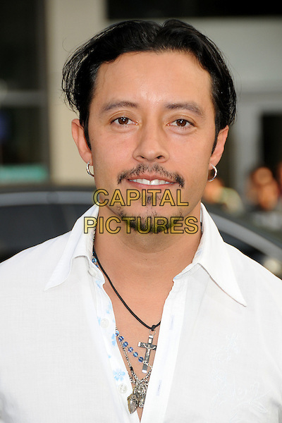 "EFREN RAMIREZ.""A Nightmare On Elm Street"" Los Angeles Premiere held at Grauman's Chinese Theatre, Hollywood, California, USA, 27th April 2010..portrait headshot white shirt soul patch moustache mustache goatee facial hair cross necklace .CAP/ADM/BP.©Byron Purvis/AdMedia/Capital Pictures."