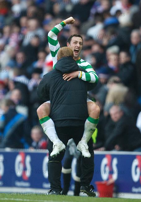 Scott McDonald jumps on Celtic coach Neil Lennon at the final whistle