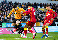 Wolverhampton Wanderers' Pedro Neto is tackled by Norwich City's Jamal Lewis<br /> <br /> Photographer Alex Dodd/CameraSport<br /> <br /> The Premier League - Wolverhampton Wanderers v Norwich City - Sunday 23rd February 2020 - Molineux - Wolverhampton<br /> <br /> World Copyright © 2020 CameraSport. All rights reserved. 43 Linden Ave. Countesthorpe. Leicester. England. LE8 5PG - Tel: +44 (0) 116 277 4147 - admin@camerasport.com - www.camerasport.com