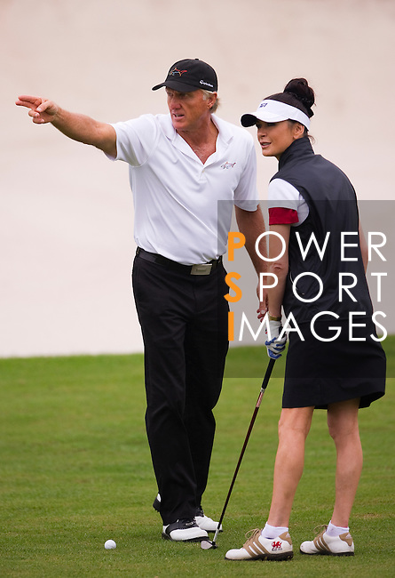 Greg Norman and Catherine Zeta-Jones during the Mission Hills Start Trophy at the Mission Hills Golf Resort on October 31, 2010 in Haikou, China. The Mission Hills Star Trophy is Asia's leading leisure liflestyle event and features Hollywood celebrities and international golf stars. Photo by Victor Fraile