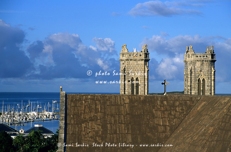 The church towers of Saint Joseph Cathedral and the Baie des Citrons, Noumea, New Caledonia.