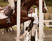 October 4, 2012. Raleigh, North Carolina.. Harold Chopping, right, of Southern Pines,NC, watches as some of his trainees practice their horsemanship.. The 2012 Hunter and Jumper Horse Show was held October 3-7 at the NC State Fair grounds, with hundreds of participants traveling from far and wide to compete.