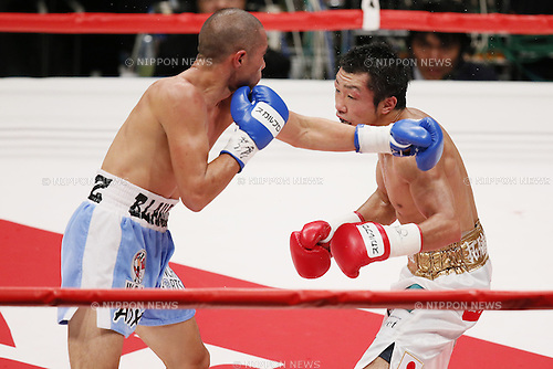 (L to R) Oscar Blanquet (MEX),Akira Yaegashi (JPN), August 12, 2013 - Boxing : Akira Yaegashi of Japan action against Oscar Blanquet of Mexico during the WBC Fly weight title bout at Ota-City General Gymnasium, Tokyo, Japan. Akira Yaegashi won the fight on points after 12th rounds. (Photo by Yusuke Nakanishi/AFLO SPORT) [1090]