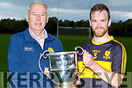 Sean Coppinger, captain of Dr Crokes accepts the  Molyneaux Cup from Cristy Kileen after defeating John Mitchels in the final on Saturday in Castleisland.