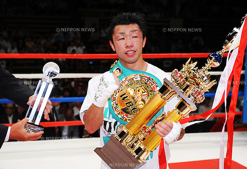 Akira Yaegashi (JPN),<br /> AUGUST 12, 2013 - Boxing :<br /> Akira Yaegashi of Japan poses with his champion belt and trophy after winning the WBC flyweight title bout at Ota-City General Gymnasium in Tokyo, Japan. (Photo by Mikio Nakai/AFLO)