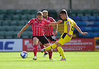 Lincoln City's James Jones vies for possession with Oxford United's Cameron Brannagan<br /> <br /> Photographer Andrew Vaughan/CameraSport<br /> <br /> The EFL Sky Bet League One - Saturday 12th September  2020 - Lincoln City v Oxford United - LNER Stadium - Lincoln<br /> <br /> World Copyright © 2020 CameraSport. All rights reserved. 43 Linden Ave. Countesthorpe. Leicester. England. LE8 5PG - Tel: +44 (0) 116 277 4147 - admin@camerasport.com - www.camerasport.com - Lincoln City v Oxford United