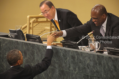 United States President Barack Obama shakes hands with John Ashe, President of the 68th Session of the United Nations General Assembly, after delivering an address to the UNGA in New York, New York on Tuesday, September 24, 2013.  UN Secretary General Ban Ki-Moon looks on from top left.<br /> Credit: Allan Tannenbaum / Pool via CNP