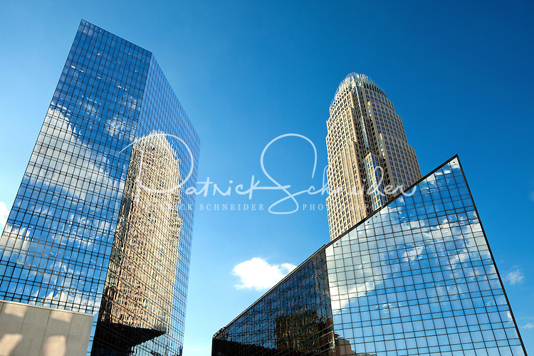 Fluffy clouds reflect in the shiny glass buildings in downtown Charlotte NC.