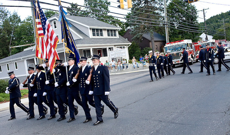 THOMASTON--9 August 08--080908TJ06 - Members of the Thomaston Volunteer Fire Department lead off their annual parade up Main Street on Saturday, August 9, 2008. (Photo by T.J. Kirkpatrick/Republican-American)