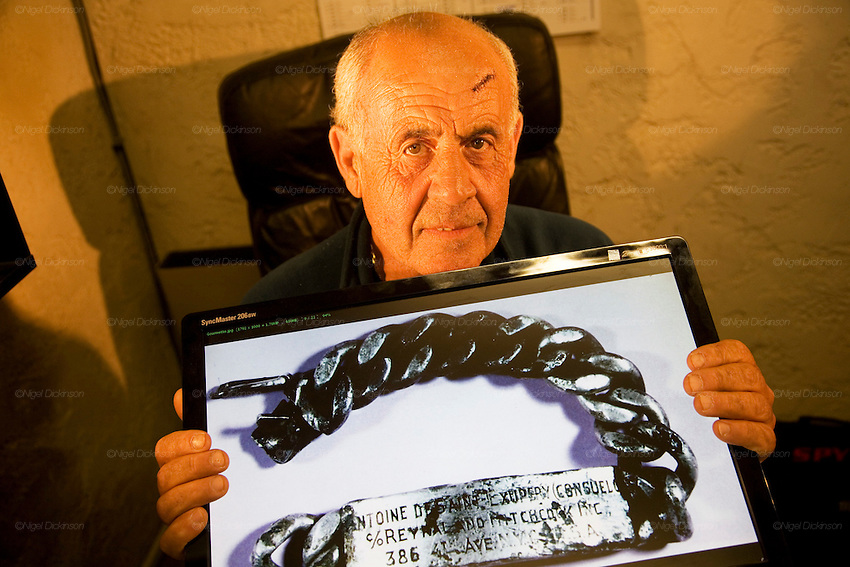 The mystery of Antoine Saint Exupery's disappearance is most likely solved by the testimony of a former Luftwaffe Messerschmitt pilot, Horst Rippert, who attests to shooting down the famous author of 'The Little Prince', who was flying a twin-tailed Lightning P-38 plane, flying below him. The chain bracelet, wrist tag, was found off the coast of Marseille in 1998, by a fisherman 'Jean-Claude Bianco'. The remains of Antoine Saint Exupery's plane was found by a diver 'Luc Vanrell' on the seabed in the same area in 2000.///Jean-Claude Bianco, fisherman, who found Antoine Saint Exupery's wrist tag caught in his fishing nets at sea off the coast of Marseille. France, East of Marseille, Montredon village.