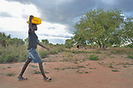 Winny Sebit, 16, carries water in the Rhino Refugee Camp in northern Uganda. As of April 2017, the camp held almost 87,000 refugees from South Sudan, and more people were arriving daily. About 1.8 million people have fled South Sudan since civil war broke out there at the end of 2013. About 900,000 have sought refuge in Uganda. <br /> <br /> The Global Health Program of the United Methodist Church has supported work to improve access to safe drinking water in the camp.